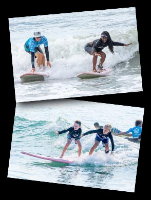 children in the water on surf boards with surf instructors